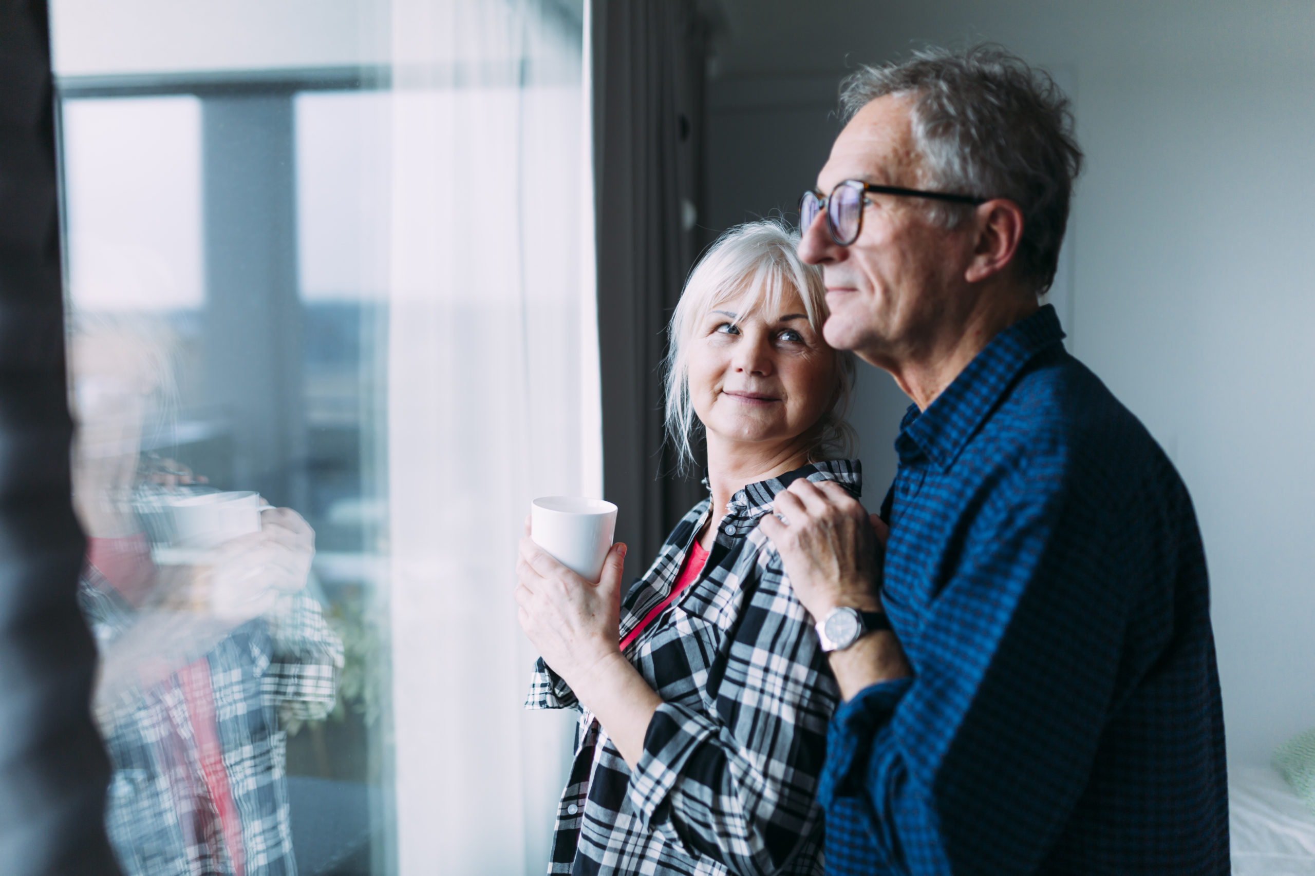 elderly-couple-retirement-home-front-window